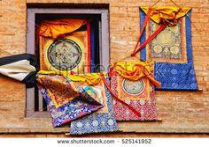 KATHMANDU, NEPAL - April 26, 2012: Buddhist mandalas in Tibetan style in a shop window on the street in Kathmandu, Patan, Lalitpur, Nepal.