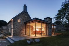 Wide Glass Wall With Fantastic Lamps Decoration As One Of The Modern Extension To The Old Stone House Along With Stone Terrace And Green Court The Modern Extension to the Old Stone House Modern Farmhouse Exterior, Rustic Farmhouse, Farmhouse Style, Farmhouse Contemporary, Contemporary Building, Urban Farmhouse, Contemporary Kitchens, Farmhouse Plans, Contemporary Bedroom