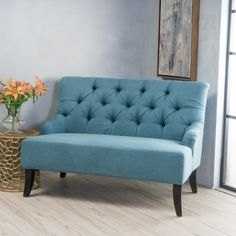 This settee offers seating with a design derived from French Colonialism. The curve of the backrest is mirrored in form by the legs giving the piece a unique elemental twist. With tuft detailing along the backrest; the Scalia Settee will add a refined and elegant touch to any room you place it in.