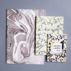 Set of three handmade marbled notebooks.Sizes 9,5 x 14 cm14 x 19,5 cm 19,5 x 28 cm SELMA LAMAI / design —selmalamai.dk