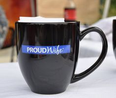 Exclusively for the Proud Wives of Law Enforcement Officers. Coffee/Latte cup. Black with PROUDWife Log on the Thin Blue Line. Makes a great unique gift too!