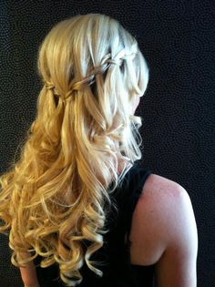 Beautiful braids and curled hair. This would be perfect for a special occasion, like graduation! :)