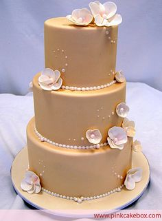 For our clients anniversary we created this 3 tier round cake. The cake is highlighted with pearl decorations including piped pearls at the base of Brown Wedding Cakes, Wedding Cake Pearls, Beautiful Cakes, Amazing Cakes, Pastries Images, Pink Cake Box, 50th Anniversary Cakes, Pearl Cake, Wedding Cake Decorations