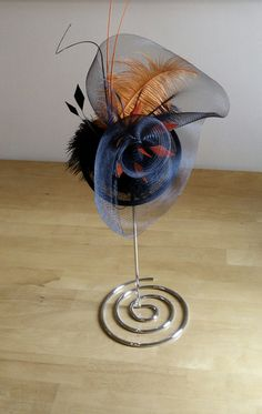 Check out this item in my Etsy shop https://www.etsy.com/uk/listing/293674675/orange-hat-fascinator-for-any-special