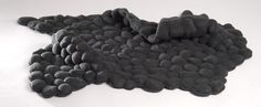 tappeto nero per massaggiare i piedi