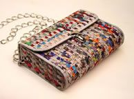 Colorful and cute. Woven from recycled newspaper. Can be used as a shoulder bag or a clutch. Bring your night life some happy planet bling.