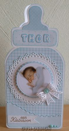 handmade baby announcement card ... die cut bottle shape ... baby blue patterned  papers with white ... die cut layered circle medallion topped with baby photo ...