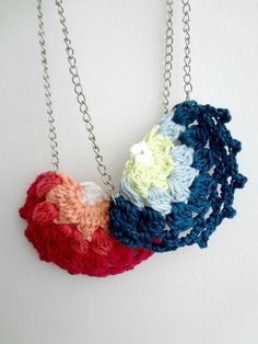 """This bright and colorful free crochet pattern will cheer you up. You will need four different colors of sport yarn, hooks, jump rings, as well as a metal chain and lobster clip, to make these half-doily necklaces. Free Crochet Doily Patterns, Crochet Doilies, Knitting Patterns, Free Pattern, Thread Crochet, Easy Crochet, Diy Necklace, Crochet Necklace, Crochet Jewellery"