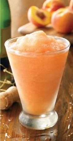 Australian Peach Bellini: a combination of peaches, champagne, vodka and peach schnapps and crushed ice! Bellini smoothie anyone! Refreshing Drinks, Fun Drinks, Yummy Drinks, Alcoholic Drinks, Yummy Food, Drinks Alcohol, Mixed Drinks, Peach Bellini Recipe, Frozen Peach Bellini