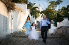 Walking in the picturesque paths of the maintown in Skyros island. Groom & his bride