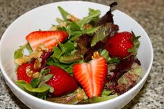 Strawberry salad.  The picture shows walnuts but the recipe calls for toasted pine nuts. I prefer pine nuts.