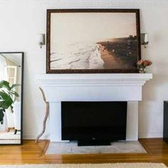 if TVs are eyesores to you, maybe set it in the mouth of an unused fireplace or right in front of it.