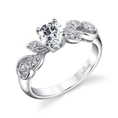 Petite flower and vine engagement ring. The milgrain and diamond detailing is so pretty. Discover our vintage engagement ring collection.