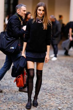 Love this look! Black crew neck sweater with collared shirt & knee high socks with flats. street style - Andreea Diaconu
