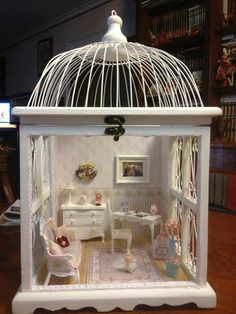 Use a bird cage for a tiny room setting. use as is or add windows and walls