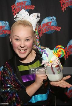 JoJo Siwa poses with the Planet Hollywood Cosmic Cotton Candy Shake as she hosts a screening of her new Nickelodeon movie 'Blurt' at Planet Hollywood Times Square on February 19, 2018 in New York City.