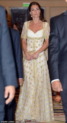 Duchess of Cambridge in a really beautiful gown. She's starting to learn...