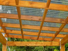 The wooden pergola is a good solution to add beauty to your garden. If you are not ready to spend thousands of dollars for building a cozy pergola then you may devise new strategies of trying out something different so that you can re Diy Pergola, Small Pergola, Pergola Canopy, Pergola Attached To House, Deck With Pergola, Outdoor Pergola, Wooden Pergola, Covered Pergola, Backyard Pergola