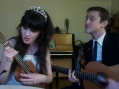 Zooey Deschanel and Joseph Gordon Levitt singing