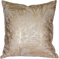 The Forest Gold Linen Pillow features a sparkling metallic gold print of winter branches on natural linen.