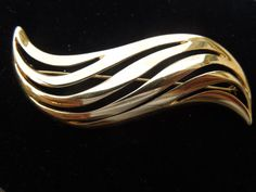 Vintage Monet Brooch, Gold Tone, Wavy Pattern, Signed  Ask a Question $12.00 USD