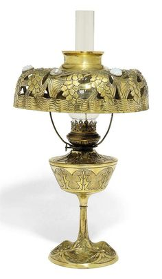 AN ART NOUVEAU GILT BRONZE AND BRASS OIL LAMP - CIRCA 1900