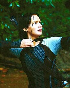 Ready position (Jennifer Lawrence as Katniss Everdeen in The Hunger Games: Catching Fire)