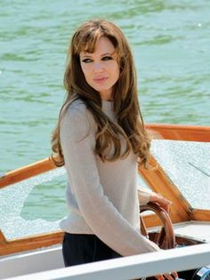 Angelina Jolie -the tourist: Love her hair color in this movie! At times it looks blond than dark brown than a rich auburn. I want the auburn of course!