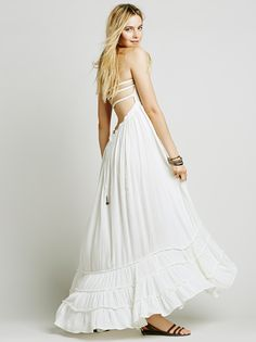 Extratropical Dress | Crinkly strapless maxi dress, made from our sheer and gauzy Endless Summer fabric, with a stretchy smocked bodice, halter neck tie, and low strappy back. Raw seam detailing on the hem. Throw on top of a bikini or layer over one of our seamless styles for an effortless look.