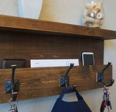 Handmade coat rack mail organizer shelf with dark bronze hooks. Perfect for any home entryway, apartment, or condo. Made of solid wood. It has been lightly sanded down, then stained and sealed with a beautiful dark walnut finish. This piece does not include the accessory items as shown in