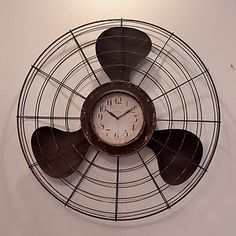 fan clock - I have this... One of my favorite pieces!