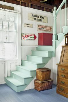 Adorable mint painted staircase in this lake cabin