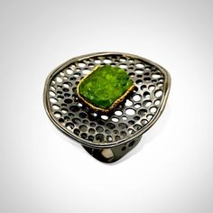 How does one keep track of structural integrity when making or designing such a piece?  Beautiful ring, looks like it's set with Peridot.