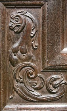 Close-up of one section of a pair of Elizabethan carved oak doors, c. 1570.