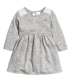 Gray melange. Fine-knit dress in soft, melange cotton with lace details. Opening at back of neck with button, seam at waist, and long sleeves.