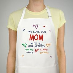 """#MothersDay All Our Hearts Personalized Mother's Day Aprons. Mother's Day will be extra special when mom wears her cherished Personalized mom Apron. All of the children can point out their own names while mom stays clean. Our Personalized mom Apron is a white full length, 65/35 cotton/poly twill fabric Apron. Machine washable. Measures 20"""" x 24"""". Includes FREE Personalization! Personalize your mom Apron with any title and up to 30 names."""