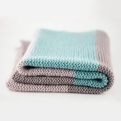 Simple Blanket – a free pattern for an easy knit baby blanket that's all done up in garter stitch. By Michelle Stewart.