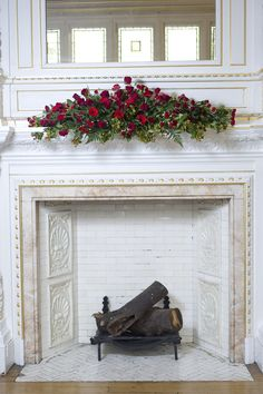 A fireplace is the perfect place to display your long and low arrangement at an event