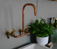 copper faucet - above Belfast sink standing on brick base. Copper Bathroom, Bathroom Fixtures, Modern Bathroom, Kitchen Fixtures, Bathrooms, Rustic Bathroom Faucets, Bathroom Interior, Belfast Sink And Stand, Belfast Sink Copper