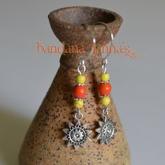 "These sunny earrings dangle at 2 1/4 inches with silver plated handmade hooks & orange & yellow colored howlite beads.   Please visit & ""like"" me on FaceBook & be notified of Give-Aways!"