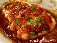 A saucy glaze forms and flavors chicken breasts with both sweet and savory notes as our Glazed Ginger Chicken simmers in the oven. Just stir together a few ingredients, pour over chicken and bake.  Brown sugar, Dijon mustard and apple cider vinegar are the base of this sauce. Fresh ginger and garlic add savory notes and touch of cornstarch creates the glaze. A delicious chicken casserole recipe for dinner tonight. Serve with broccoli and a salad and you're all set!