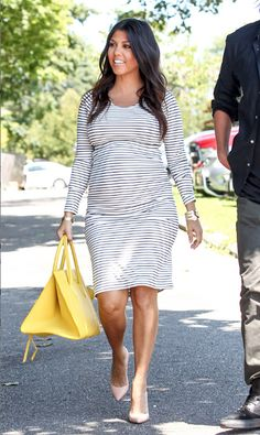 Just when we thought her maternity wardrobe couldn't possibly get any more stylish, Kourtney Kardashian continued her winning streak with another great look.  Get Kourtney's Top Here: http://rstyle.me/n/iiagemxbn