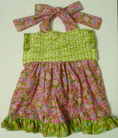 Little girls dress using jelly roll, layer cake and fat quarters.  Pattern included