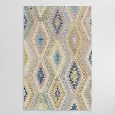 Densely handcrafted of 100% wool to minimize shedding, our area rug features an intricate design with subtle color variations due to hand-finished tip shearing.