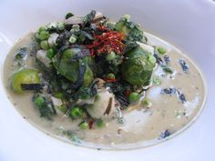 Super Greens Bowl with coconut cream  2cups water 1tbsp thick coconut cream 1/2 veg stock cube 1tsp basil,dill,garlic(minced),cumin,sesame seeds,hemp hearts 2tsp olive oil 1 handful each of brussel sprouts,broad beans,peas,and spinach 1 tbsp dried nori 5 water chestnuts,chopped sea salt and pepper   Add oil,spices and garlic. Toast spices first to bring out the flavour,& add the liquids. Add veggies and warm through. Sprinkle with nori and serve. A lotus raw vegan original recipe*