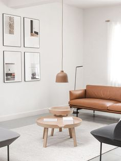 Contemporary living room with low hanging pendant lamp.