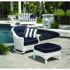 Lloyd Flanders Embassy Lounge Rocker. This comfortable classic rocker features plush cushions and your choice of wicker finish. http://www.furnitureforpatio.com/lloydflandersembassyloungerocker-25033.aspx