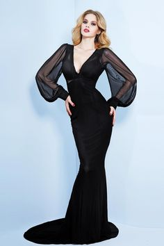 Our most dangerous and ever-popular, Lara Stone Dress has been reimaged this season into an elegant 1930's inspired floor-length gown. Dangerous sheer black chiffon is styled to perfection in this stunning boudoir inspired dress. Seductive panels lined throughout the body form a firm and sleek fit. With decadent voluminous sleeves and luxurious sleek silhouette, this piece is resplendent in its old Hollywood homage! Delicate gathers at front and deep-V neckline finish this kn…
