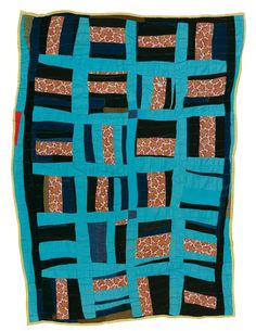 """A Gees Bend quilt by Deborah Pettway Young, 1916-1997. One side of two-sided quilt: """"Roman Stripes"""" variation, ca 1960, cotton twill, print, jersey knit, denim, polyester, 83 x 64 inches"""