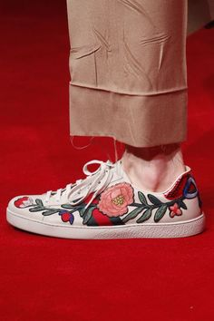 Spottet on the runway: Gucci sneakers with floral applications.